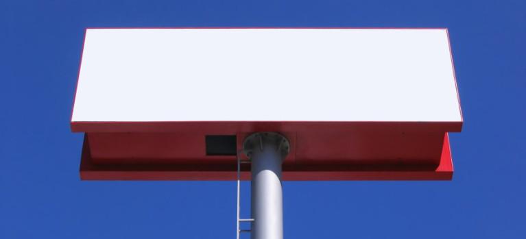 Large white blank billboard over blue sky